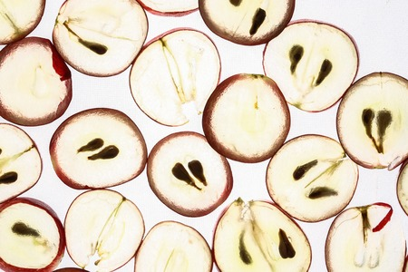 Slices of grapes on a white background