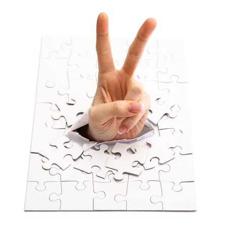 Womans hand in the puzzle photo