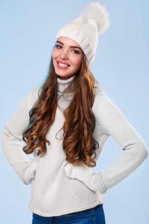 Winter. Cute girl on a blue background photo