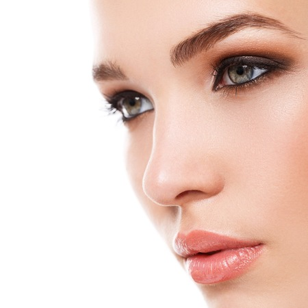 face close up: Beauty, spa. Attractive woman with beautiful face