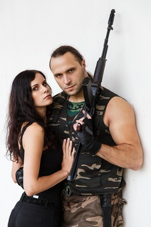 radical love: War, conflict. Guy with girl on a battlefield