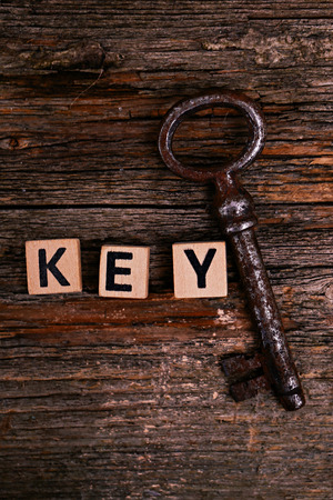 Old, rustic keys on the table photo
