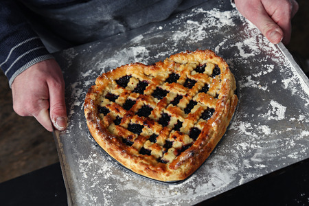 Valentine, love. Delicious homemade pie with heart shape photo