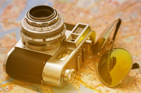 Photography, vintage. Retro camera with sunglasses photo