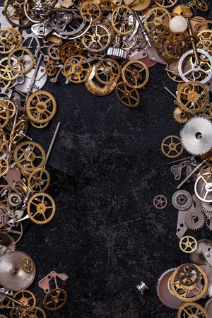 Details, technology. Heap of small gears on the table photo