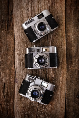Photography, vintage. Retro camera on the wooden table photo