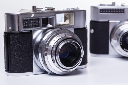Photography, vintage. Retro camera on a white background photo