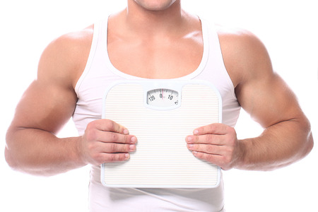 Muscular guy with scales on a white background photo