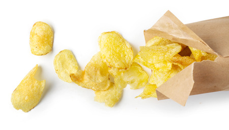 Delicious potato chips on a white background