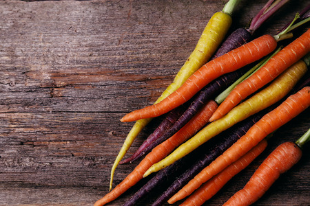 marchew: Food. Delicious carrot on the wooden table