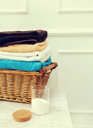 Laundry. Wicked basket with clean towels photo