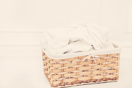 Laundry. Wicker basket with dirty towels photo