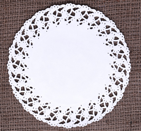 doily: White doily on the vintage tablecloth