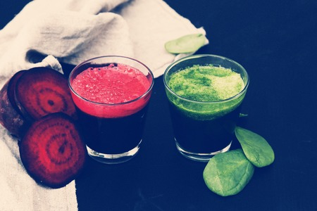 Beetroot and spinach drink on a wooden table photo