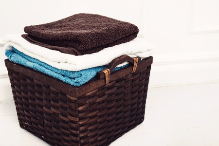 cleaning background: Laundry. Wicker basket with clean towels Stock Photo