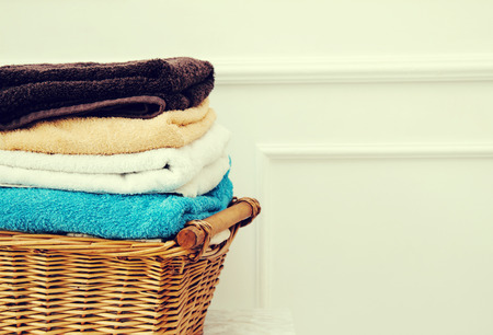 Laundry. Wicker basket with clean towels photo