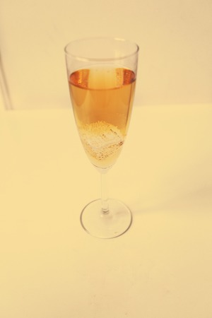 Glass of champagne on the table photo