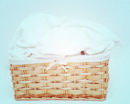 Laundry. Wicker basket with white towel photo