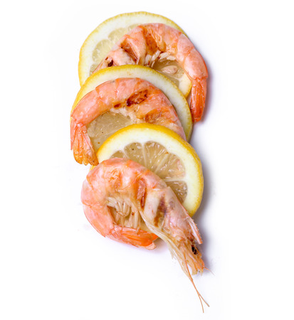 Delicious shrimps on a white background photo