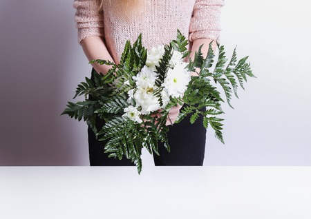 Woman with soft skin making a bouquet photo