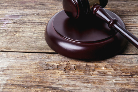 court process: Judge hammer on the wooden table