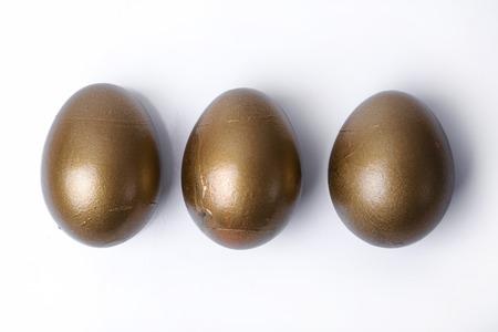 golden egg: Business, finance. A rare golden egg Stock Photo