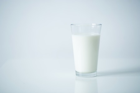milk products: Glass of milk on the table