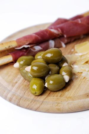 Delicious snacks on a white background photo