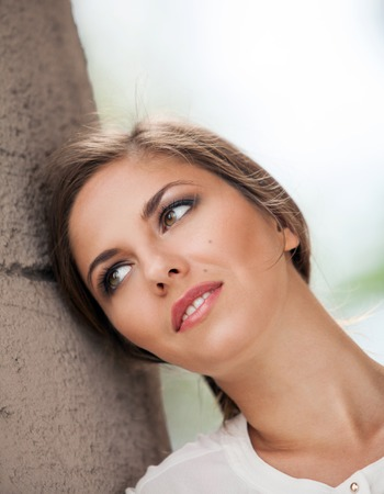 cheekbones: Portrait of beautiful young caucasian woman with makeup outdoors