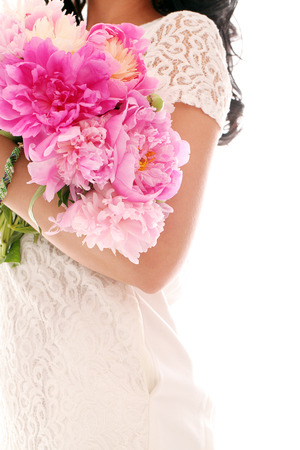 pion: Beautiful bouquet of rose peonies in womans hands