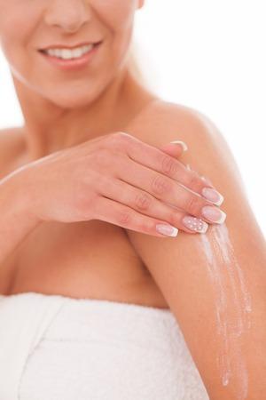 white cream: Beautiful woman massage herself with white cream