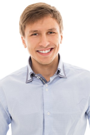 25 29: Handsome man in a blue shirt smiling over a white background
