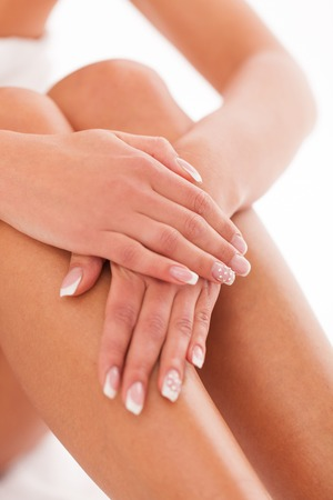 french manicure sexy woman: Beautiful woman legs and hands in a spa Stock Photo
