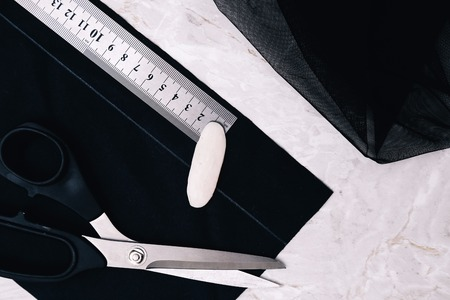 Sewing tools on a black background photo