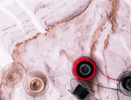 Sewing tools on the marble table photo