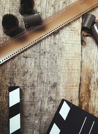 cinematography: Cinematography. Vintage tape on the wooden table