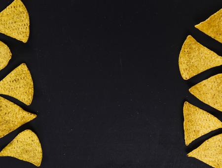 totopos: Potato chips on a black background