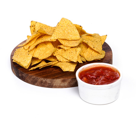 totopos: Potato chips with sauce on the table Stock Photo