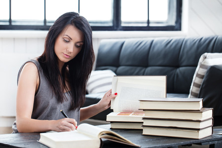 Lifestyle, study. Beautiful girl with a book Imagens