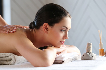 massager: Beauty. Girl in the spa salon
