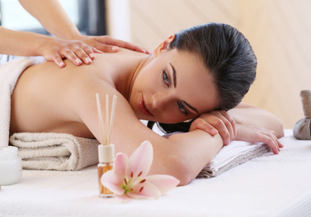 massage herbal: Beauty. Girl in the spa salon