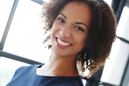 working dress: Office, lifestyle. Woman with African-American hairstyle Stock Photo
