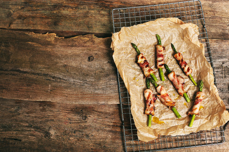 baked meat: Food. Delicious asparagus with bacon