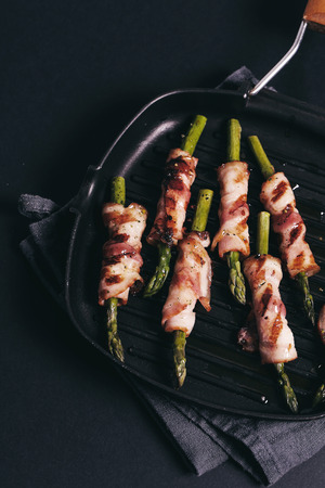 oiled: Food. Delicious asparagus with bacon