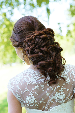 Beautiful bride with gorgeous hairstyle outdoor