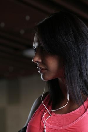 listened: Beautiful sport girl listened to music