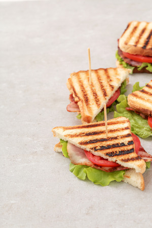 toasted sandwich: Food. Delicious BLT sandwich on the table