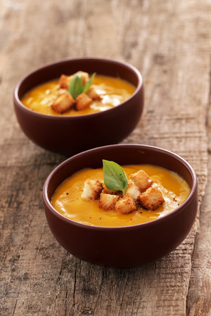 Delicious pumpkin soup on the table