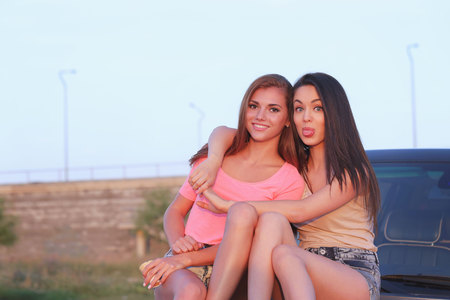 lesbian sexy: BFF. Two cute girls at street Stock Photo