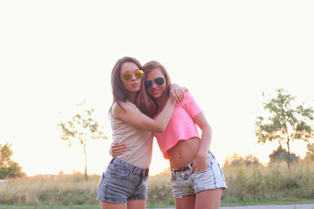 bff: BFF. Two cute girls at street Stock Photo
